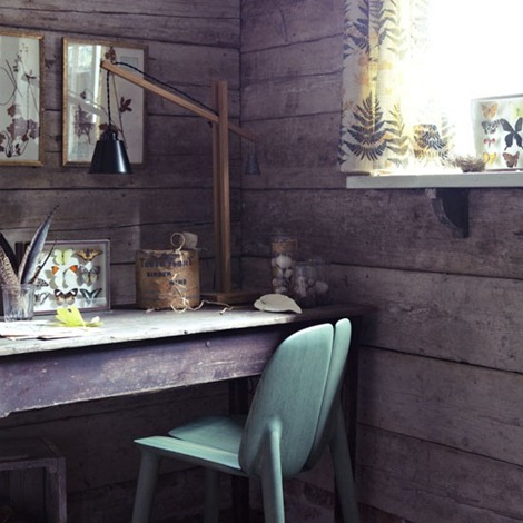 Wood-panelled-room-with-a-vintage-collection-of-nature-inspired-accessories